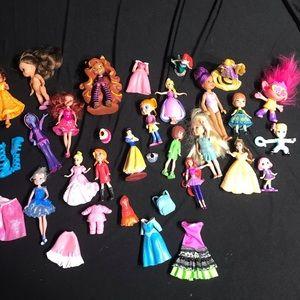 Bundle of small dolls